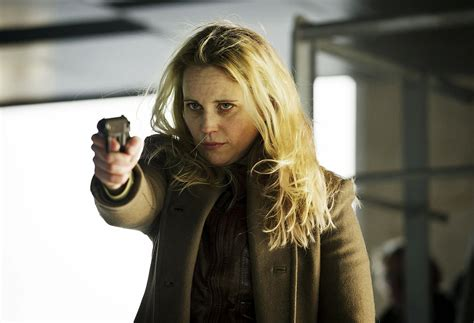 The character Saga Noren holding a gun.